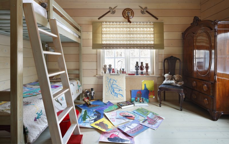 Интерьер детской в доме из бруса