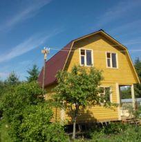 Дом из бруса с мансардной крышей